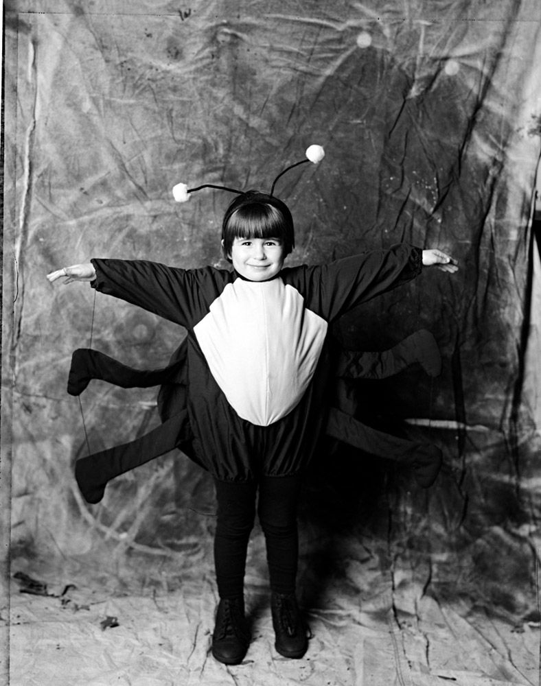 Larry Racioppo D-05-Girl-in-Bug-Costume,-18th-Street,-1996-.jpg