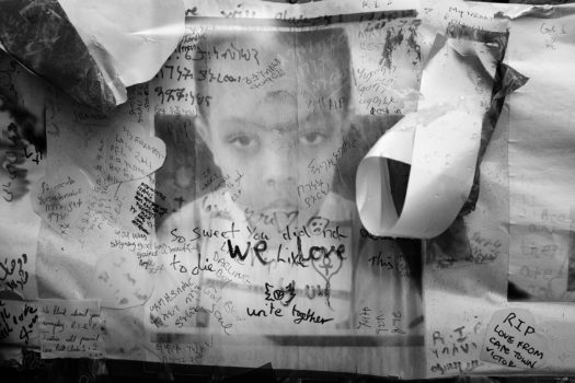 Photograph of victim Isaac Paulos, memorial wall, Bramley Road. Isaac lived on the 18th floor of Grenfell Tower.