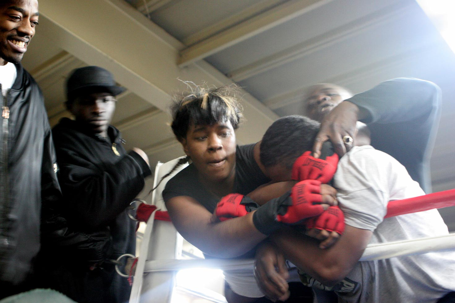 The girls fight in martial arts training gloves.