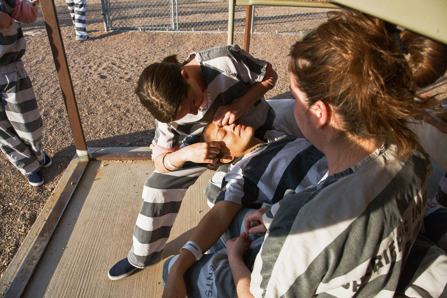A female inmate getting her eyebrows done.