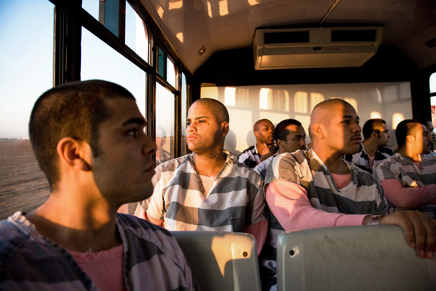 Inmates on the bus at dawn, going to work as a chain gang.