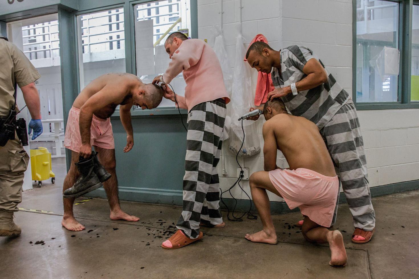 Inmates getting their hair cut.