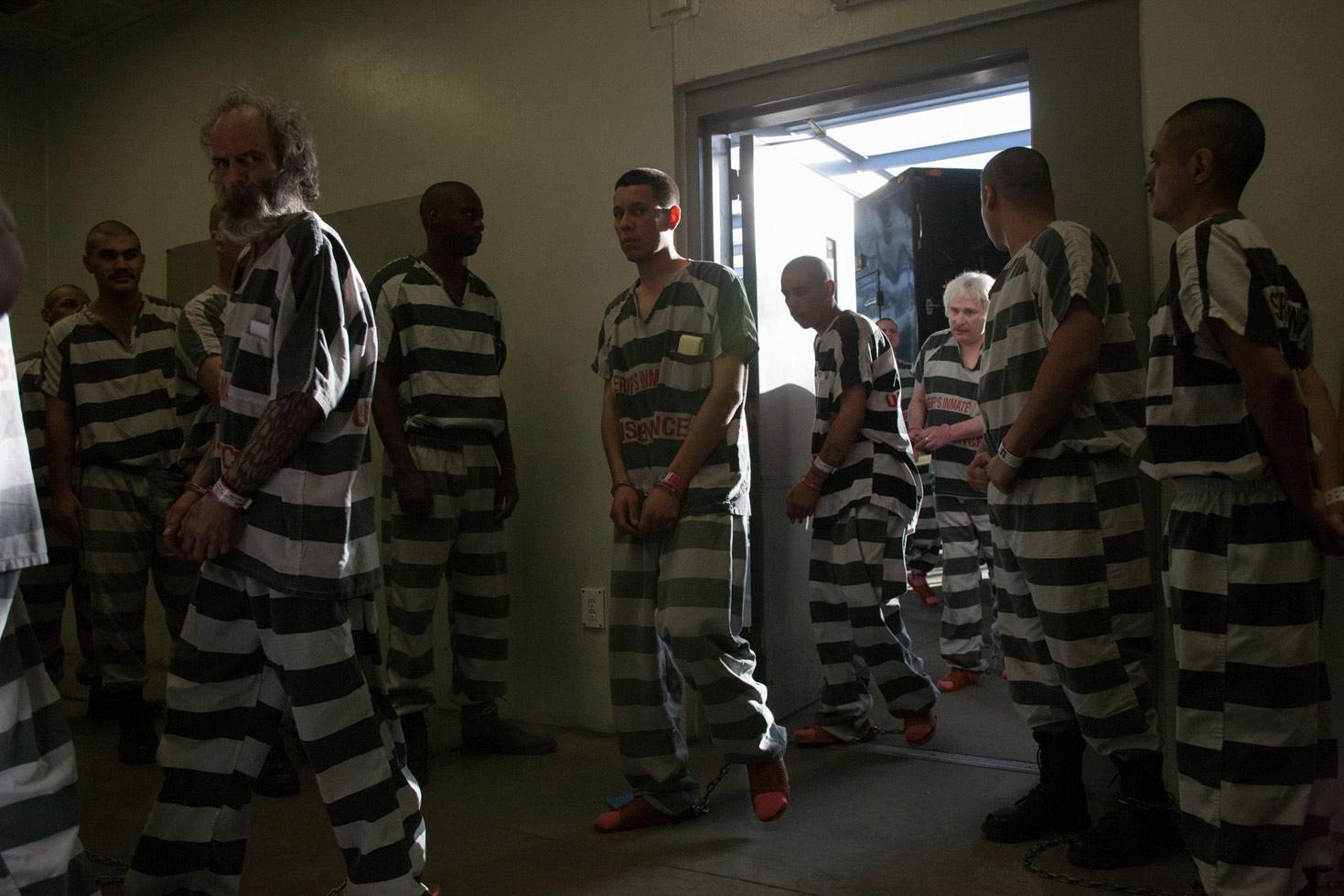 Inmates entering Estrella Jail at dawn.