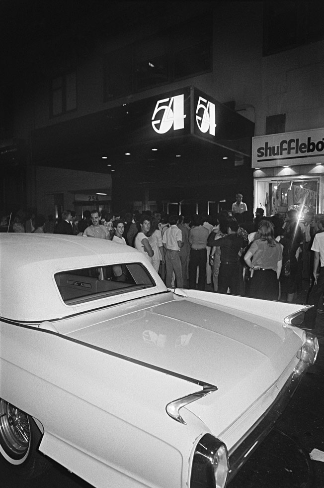 """""""Marc Benecke called the shots outside Studio 54, along with Steve Rubell. This was the scene most nights as people waited for hours to be chosen to enter the grand party. Sometimes pulling up in a Bentley or Cadillac helped, but not always. Nobody was interested in getting into Shufflebottoms, the club next door."""""""