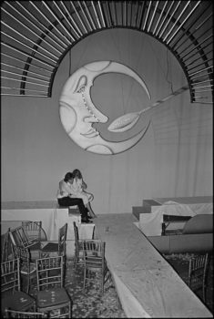 """This shot was taken at Studio 54 at closing time one night, I noticed this couple under the famous Moon and Spoon. Romance, in a blitzed-out Studio 54 kind of way."""