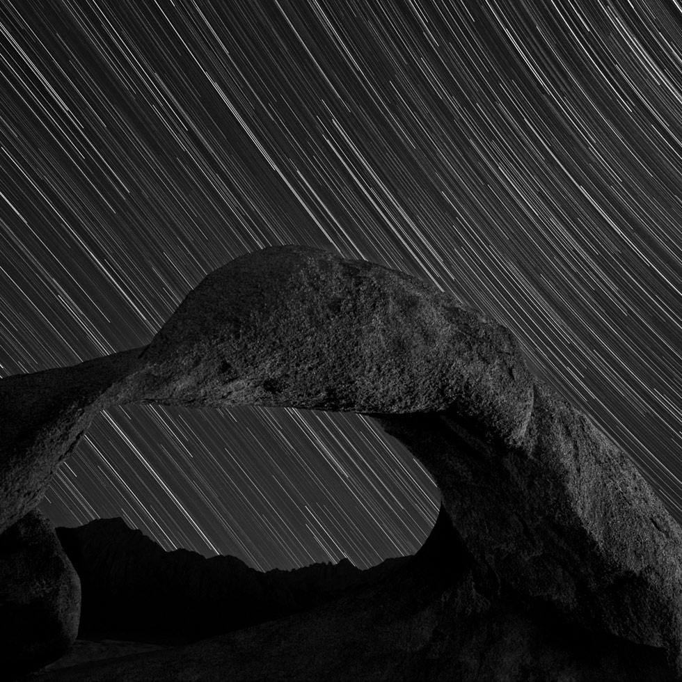 Drift away with Don Whitebread's long exposures of the night sky. This selection was made in California.  Firelight on Mobius Arch