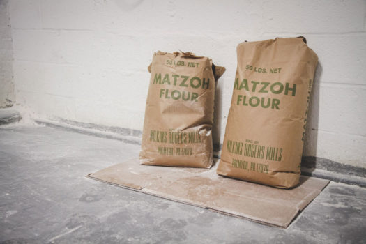 Streit's was making matzos there since 1925, operating two 75-foot ovens, producing 900 pounds of matzo per hour.