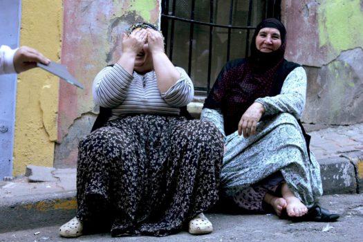 Kurdish women taking a break from their work preparing mussels.