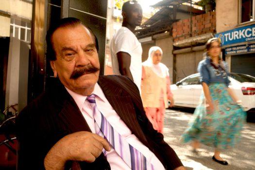 Rhami Pala, an old Turkish actor, enjoying Kurdish, Gypsies, Armenians and Africans passing at the crossroads.
