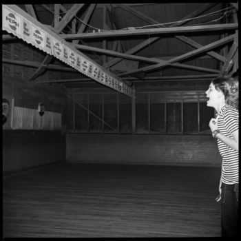 """In 1972, Bill Yates discovered a weekly party that he would come to photograph for several months. """"I had just purchased a medium format, twin lens camera and, as usual, I was out riding around looking for something to shoot. I happened upon an old wooden structure built in the 1930s in the Six Mile Creek area of rural southern Hillsborough County, Tampa, Florida. The sign on the building read """"Sweetheart Roller Skating."""" The owner was just driving up. """"Mind if I shoot some pics?"""" I asked. """"Sure, but if you want some good ones, come back tonight, this place will be jumpin'."""""""