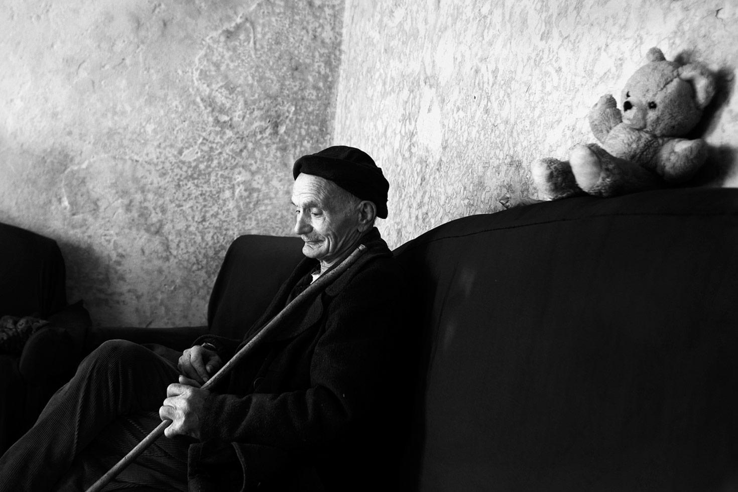 A man in his neighbor's house.  Shkoder, Albania, 2012