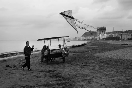 A couple selling their goods at the beach, even during winter months, when almost no-one visits.