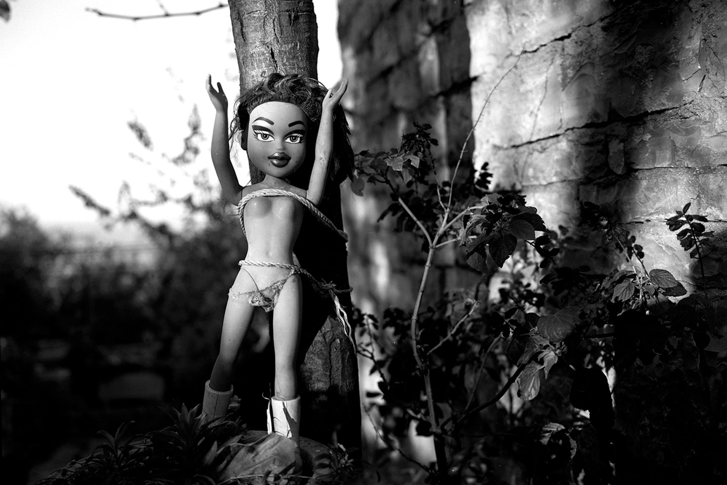 A doll strung to a tree. People believe this will remove negative energies from their home and family.  Shkoder, Albania, 2009