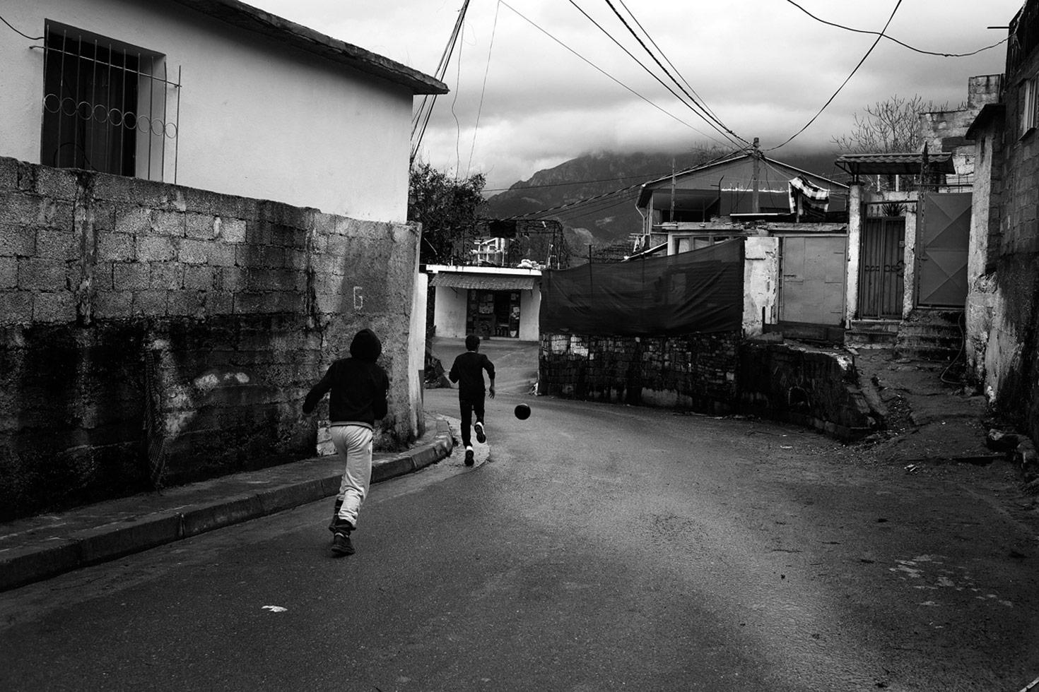 Boys playing in their neighborhood.  Tirana, Albania, 2012