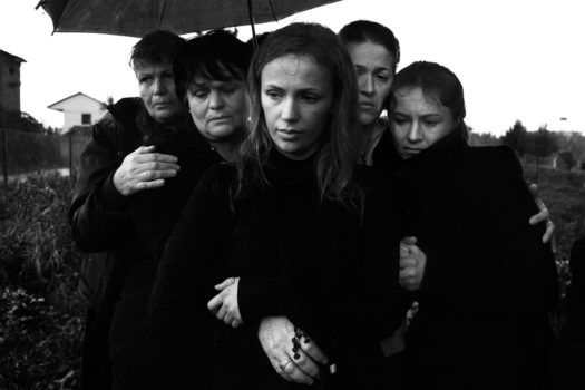 Enri Canaj left Albania age 11, and returned as a photographer to explore the vague memories of his home country.  At a funeral, where men are traditionally separated from the women.  Tirana, Albania, 2012