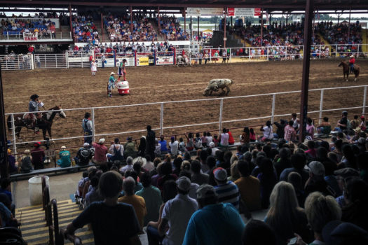"At the first rodeo, spectators sat on apple crates and the hoods of cars. The initial success led to the construction of a small arena in 1969. In the late 1990s, a trustee of the Irene and CB Pennington Foundation, Darryl Pennington, set the dream of a new, 10,000-seat multi-purpose arena in motion. The official Professional Rodeo Cowboys Association rules were adopted in 1972, and organizers contract with professional rodeo stock providers for supplies, and hire professional judges and rodeo clowns. Even with all the precautions, one inmate said that, ""It gets pretty crazy out there at times."""