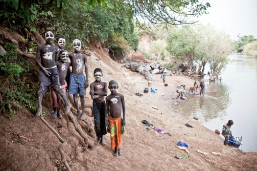 Young boys pose for a portrait on the banks of the River Gambia in Senegal. They said they had painted their faces like skulls for their own amusement.