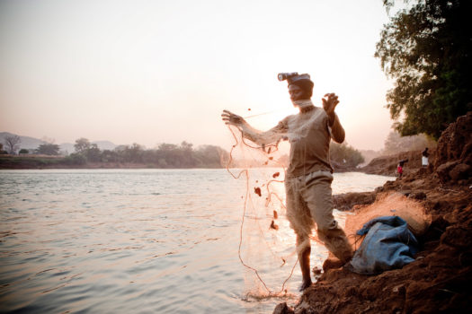 Malian fisherman and expedition guide Yousef Keita prepares his fishing nets at the village of Mako on the edge of Niokolo Koba National Park, Senegal.