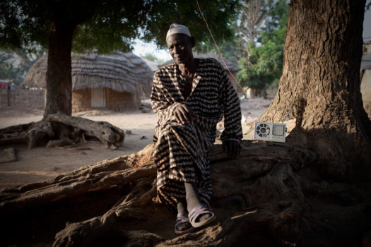 Bakary Dabo, the Alkalo (village chief) of Diagabu Tenda, a small settlement on the banks of the River Gambia. The position is unpaid, and the Alkalo is responsible for negotiating disputes, giving land rights and also to be the host and protector of visitors to his village.
