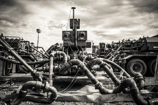 This is what fracking looks like from the surface. The pipes leading into the well head are connected to the trucks in the background. These trucks force water mixed with proppant - sand and tiny ceramic balls that keep the cracks propped open (hence the name) so that oil can flow towards the well pipe - and chemicals down into the well at 10,000 PSI.  Text and images by John Mireles