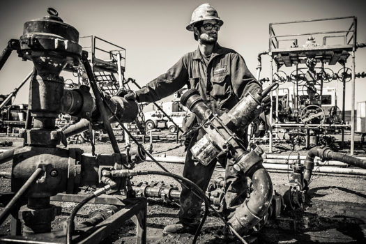 This man is setting up the massive series of pipes that will be used to hydraulically fracture this well. The fittings are tightened into place by sledgehammer. The pressures are so high that if a fitting is not properly tightened, it will explode. Once a well is under pressure, no one is allowed to walk or stand in the area.