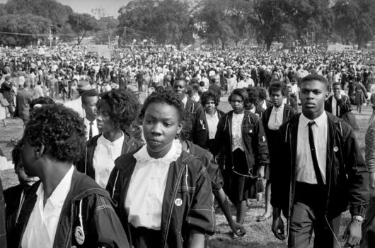 """""""'The March on Washington for Jobs and Freedom' called for the desegregation of public schools, protection of the right to vote, and a federal program to train unemployed workers."""""""