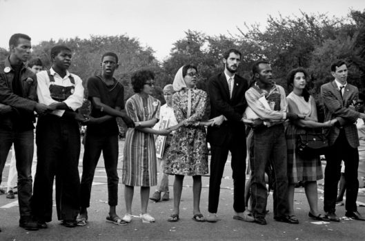 """""""[Freed] allows the images to steep in the crucible of American race. One can almost catch the subliminal suggestion: This is what it should always be like. The photograph of blacks and whites linking arms in the culminating rendition of """"We Shall Overcome"""" is sweet 'I sing' in the cake of unity."""" Michael Eric Dyson."""
