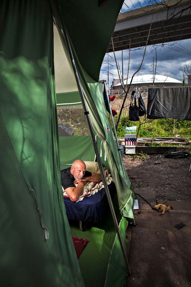 When I first met Russell he was living inside a bridge. When he moved to this camp he had a wooden shanty until the neighboring business donated a tent and a cot. He says this is the best home he has ever had.