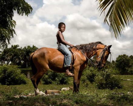 Oscar, 8-years-old, works with his father in the fields every day, tending to their animals. Their five goats, two cows, two horses and five chickens serve as a form of insurance. This horse, valued at 4,000 pesos ($120), would only be sold in the case of a family emergency. Oscar's mother runs a community store, which provides the family's modest income.