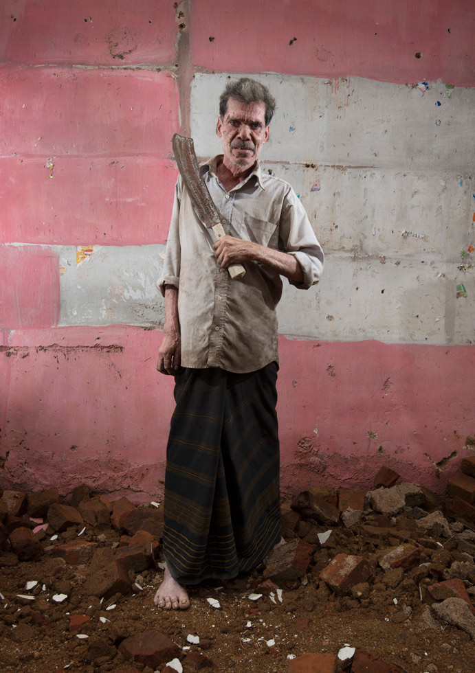 """Ambatenna, Sri Lanka, 2012 """"Sunil crafted this machete from leaf spring steel, which is recovered from scrapped cars and trucks. It's a popular metal among blacksmiths to make blades due to its high quality. He finished the machete just a few weeks prior to this shoot."""""""