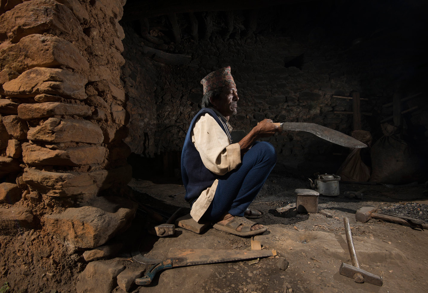 """Falante, Nepal, 2012 """"Man Bahadur is a 4th generation blacksmith and part of the Nepalese Kami caste. He made this khukuri for me over the course of 3 days."""""""
