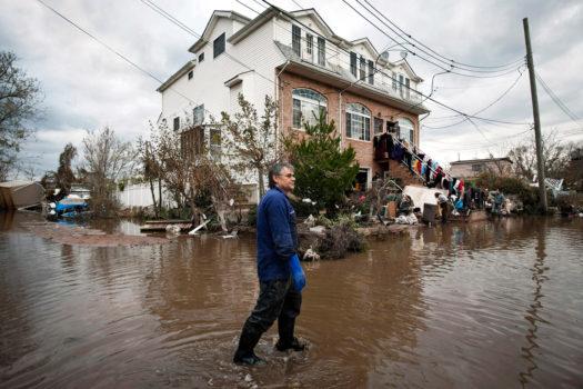 Andrezeg and Lydia Rozoszak next to their home, Midland Beach, Staten Island, November 2, 2012