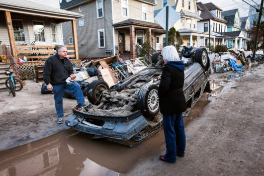 Gregory Piechocki and Vicky Shteyn next to their homes on Beach 119th Street, Rockaway, Queens, November 4, 2012