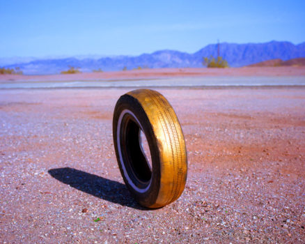 Rob Hann: Tucson to Tucumcari  Amboy Road, California  I was amazed to see this tyre standing by the side of the road in the Mojave Desert. There was a large stick insect living inside it.