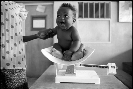 """""""Children are the reward of life."""" Congolese proverb  Maternal health clinics encourage mothers to bring their children for checkups as a way to improve the health of mothers and children.   Kigali, Rwanda, 1993"""