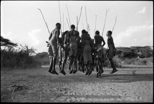 """""""If you can talk, you can sing, if you can walk, you can dance."""" Zimbabwean proverb  Maasai men dancing a traditional warrior dance.   Northern Kenya, 1990"""