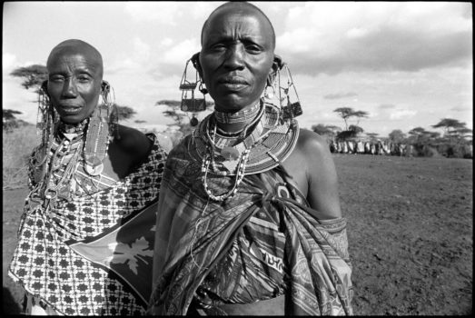 """""""Where there are two people, there is double wisdom."""" Zambian proverb  Two Maasai women at a blessing ceremony.  Southern Kenya, 1995"""