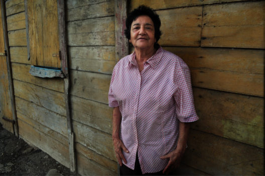 """""""A couple of years ago, in a small Dominican town near the Haitian border, I met and became friends with Georgette Michelen and her family. Georgette lives in a beautiful, enormous wooden house her father built at the beginning of the last century: 'The House of the Sun.'"""