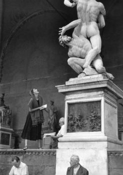 """Jinx Staring at the Statue  """"In the morning, while the Italian women were inside preparing lunch, Jinx gawked at statues, asked military officials for directions, fumbled with lire and flirted in cafes while my mother photographed her. They had a lot of fun..."""""""