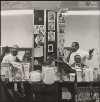 """Jeffrey Henson Scales   """"Buy Black, 1986–1992."""" From series """"House's Barbershop, Harlem""""  Gelatin silver print. Museum of the City of New York. Museum purchase."""