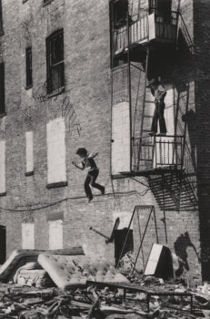 """Martha Cooper  """"Lower East Side [Boy Jumping from Fire Escape]""""1978 (printed later)  Gelatin silver print. Museum of the City of New York. Museum purchase."""