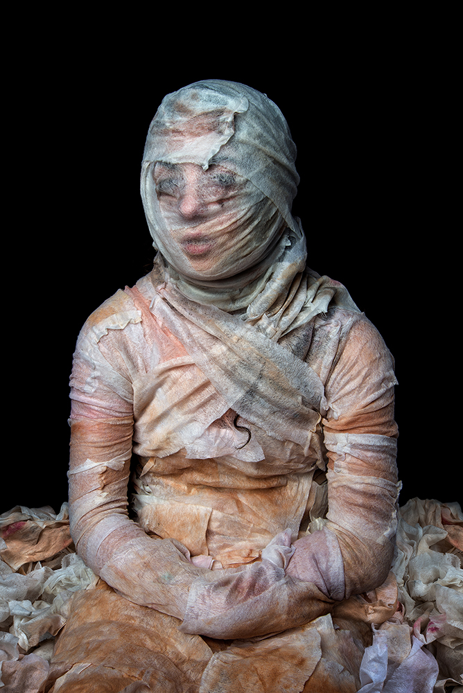 """""""The application of makeup in the morning and the removal at night is a daily ritual for many women. By collecting used makeup remover wipes from one hundred women, placing them back over the figure and photographing them, these images embody this repetitive beauty ritual."""""""