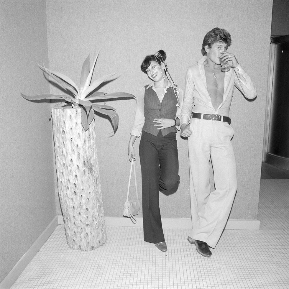Twosome next to a palm tree, New York City, 1977