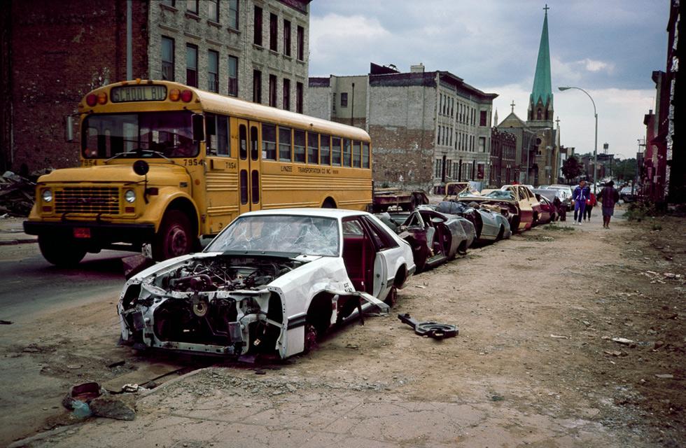 School bus and curbside crushed cars, Bushwick, Brooklyn, NY, 1985