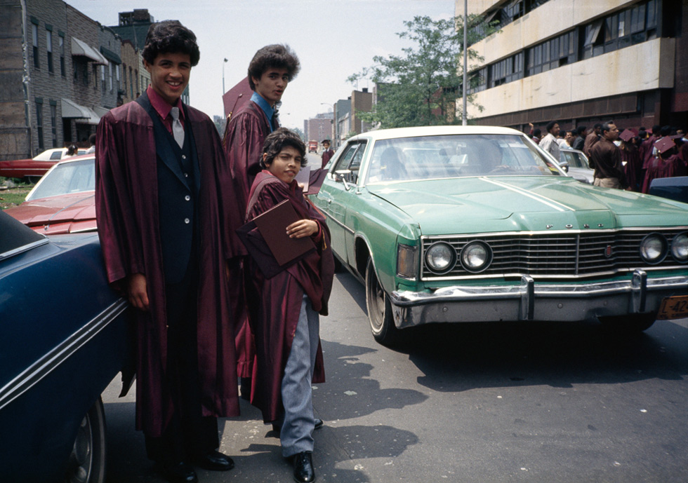 Grads pose near cars, Bushwick, Brooklyn, NY, 1982
